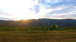 man climbs the mountains at dawn