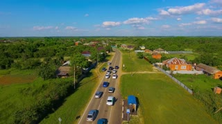 many cars drive along the rural road, top view, drone 4k