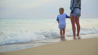mom and son are on the beach