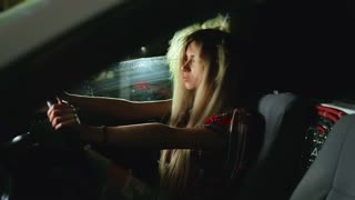 the girl's hair evolves from loud music in the car