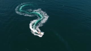 Top view of a white boat sailing in sea