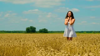 young girl in a golden wheat field