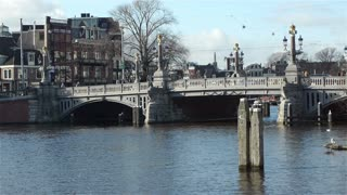AMSTERDAM, THE  NETHERLANDS - February 27, 2015: Bridge and canal in Amsterdam