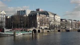 AMSTERDAM, THE  NETHERLANDS - February 27, 2015: Carre theater and canal in Amsterdam