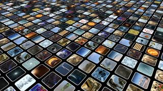 Animated video wall with many small icons on monitors, diagonally. Loop-able. 3D rendering. 4K