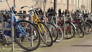 Bikes and walking people in Amsterdam
