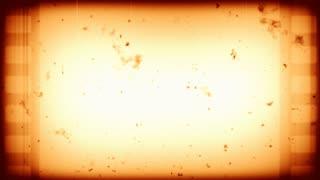 Blood splatter on old sepia film reel