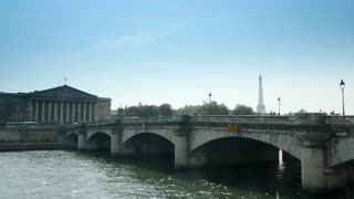 Bridge over Seine with Eiffel Tower in the distance, Paris, France