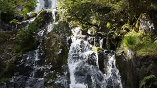 Cascade or waterfall with green rocks