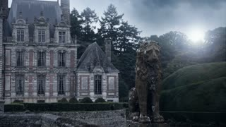 Chateau de Beaumesnil and an old statue
