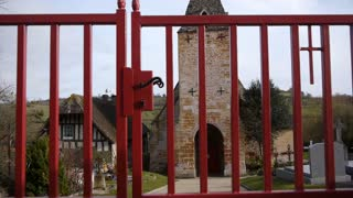 Historic church opening gate in Guerquesalles France