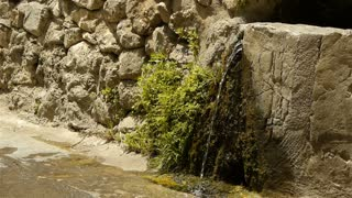 Historic wall and pure water at St Guilhem le Desert, Cevennes France