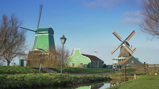 Historic wooden houses and windmills at the Zaanse Schans. Holland 4K