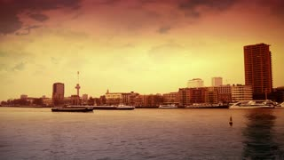 ROTTERDAM, THE NETHERLANDS - JANUARY 21, 2015: The river of Rotterdam from the Erasmusbrug at sunset 4K