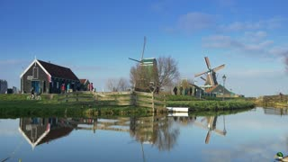 Touristic wooden houses and windmills at the Zaanse Schans. Holland 4K