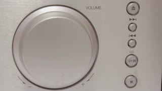 Turning a volume knob 4K