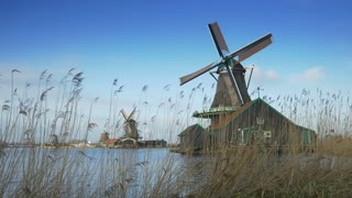 Turning windmills at the Zaanse Schans. Holland 4K
