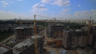 Aerial shots of construction sites , concrete buildings and industrial cranes.General plan