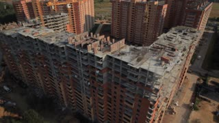 Aerial.Construction and development in Russia. New areas of Moscow. The camera flies around the buildings