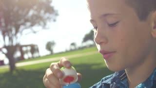 Boy blowing bubbles, slow motion