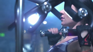 Brunette strong fitness sexy woman doing exercise in a gym