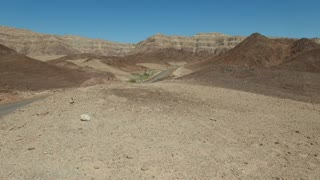 Car crosses the desert. Aerial shot.Desert view from the top