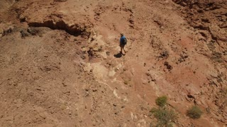 Climber in the mountains, moving towards the goal. Aerial view