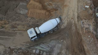 Concrete mixer at the construction site.Aerial shots from close-up truck to the General plan of the site