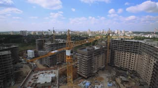 Industrial cranes on a construction site,aerial view