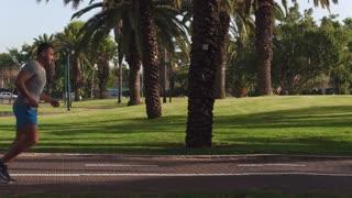 Jogger running through park