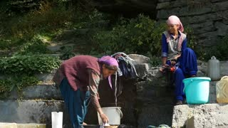 MANALI, INDIA - 24 SEPT 2016: Indian women wash clothes