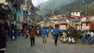 MANALI, INDIA - 25 SEPT 2016: People walk on the main street of the old town of Manali in the Indian Himalayas