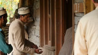 MANALI, INDIA - 26 SEPT 2016: Heavy manual labor in the Indian village of simple farmers