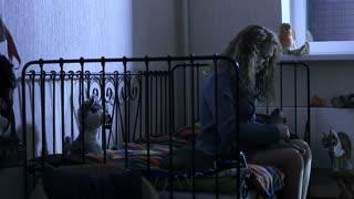 Manic depressive psychosis. Girl in depression sitting in a dark room