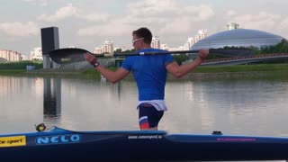 Moscow, Russia - 11 July 2016: Kayaker warming up before a swim