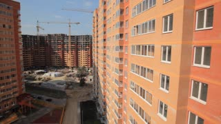 New buildings for young families in Moscow. The camera moves close to the Windows of the building