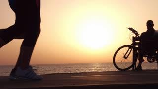 Running sport athletes woman and man jogging at night sunset.