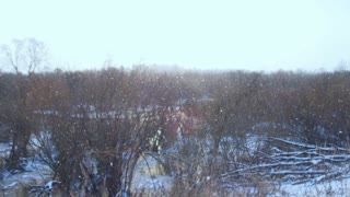 Snowfall in a magical valley.Panoramic shot of falling snowflakes in the foreground