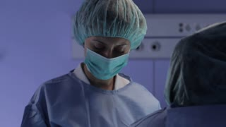Surgical medicine. The surgeon operates the patient
