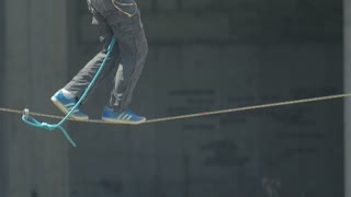 Tightrope walking on a high rope stretched