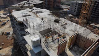 Urban development, construction of new homes. The view from the top of the construction site