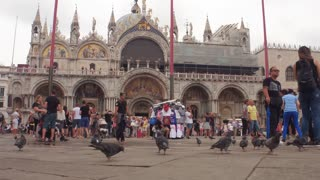 VENICE, ITALY - JUNE 20, 2016: A crowd of tourists in front of the Basilica di San Marco in Piazza San Marco in Venice, Italy