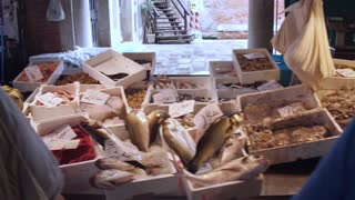 VENICE, ITALY - JUNE 20, 2016: Shooting of fresh seafood and fish for sale at a market Rialto, Venice, Italy