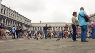 VENICE, ITALY - SEPT 15, 2016: A crowd of tourists in front of the Old and New Procuratie on Piazza San Marco in Venice, Italy