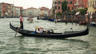 VENICE, ITALY - SEPT 15, 2016: Gondola with tourists in the Grand Canal (Canale Grande) at Venice (Venezia) Veneto Italy
