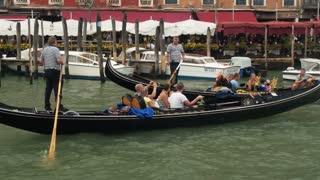 VENICE, ITALY - SEPT 15, 2016: Gondolas with tourists in the Grand Canal (Canale Grande) at Venice (Venezia) Veneto Italy