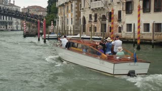 VENICE, ITALY - SEPT 15, 2016: Taxi boat with tourists near the Academy Bridge in the Grand Canal of Venice, Italy