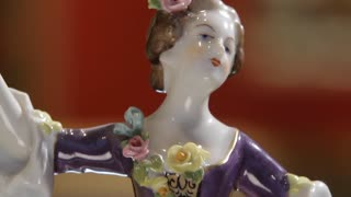 A delightful statue of a dancing girl. Porcelain.