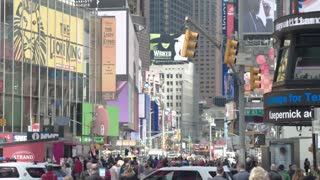 A tourist and commercial center of Manhattan, Times Square. Skyscrapers with electronic billboards, advertising, tourists. Dolly shot.