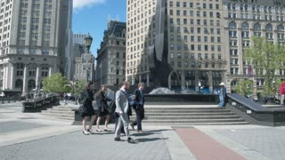 Architecture and squares of Manhattan - Foley Square. Steadycam shot, the camera moves around the fountain.